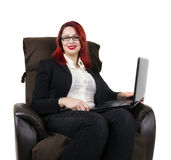 Cheerful redhead business woman and glasses. White background Royalty Free Stock Photography