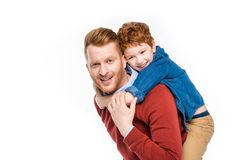 Cheerful redhead father and son hugging and smiling at camera. Isolated on white Royalty Free Stock Photos