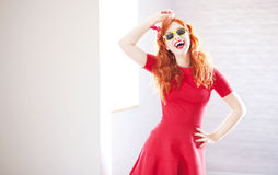 Cheerful redhead girl Stock Image