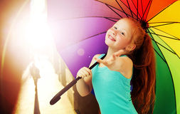 Cheerful redhead girl with an umbrella Royalty Free Stock Photo