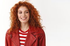 Cheerful redhead modern stylish woman heading work good mood getting hair done curls smiling delighted look aside dreamy. Lovely memory recalling standing white royalty free stock images
