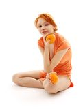 Cheerful redhead with two oran Royalty Free Stock Photos