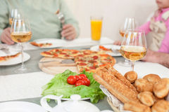 Cheerful relatives are dining together with joy Stock Photography