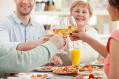 Cheerful relatives are dining together with joy Royalty Free Stock Photography