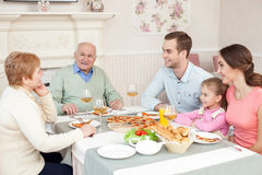 Cheerful relatives have a dinner in cafe stock photo