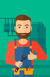 Cheerful repairer with spanner. Royalty Free Stock Images