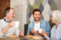 Cheerful resting I the cafe with his grandparents Royalty Free Stock Photo