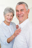 Cheerful retired couple looking at camera Stock Images