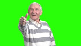 Cheerful retired grandfather showing his approval. Front view grandpa showing and moving thumb stock video
