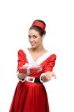 Cheerful retro girl holding christmas gift Stock Photos