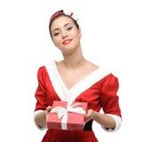 Cheerful retro girl holding christmas gift Stock Image
