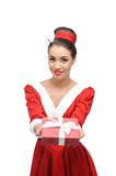 Cheerful retro girl holding red gift Stock Images