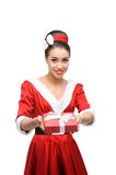 Cheerful retro girl holding red gift Stock Photo