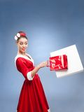 Cheerful retro girl holding shopping bags Royalty Free Stock Image