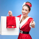 Cheerful retro girl holding shopping bags Stock Photography