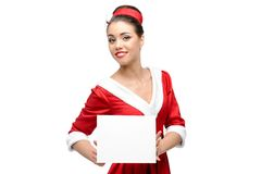 Cheerful retro girl holding sign Stock Image