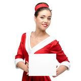 Cheerful retro girl holding sign Royalty Free Stock Photos