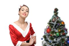 Cheerful retro girl standing near christmas tree Stock Photography