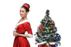 Cheerful retro girl standing near christmas tree Royalty Free Stock Photo