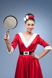 Cheerful retro housewife Stock Photography