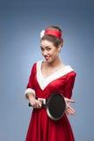 Cheerful retro housewife Royalty Free Stock Photos