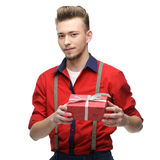 Cheerful retro man holding gift Stock Photography