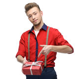 Cheerful retro man holding gift Stock Photo