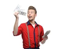 Cheerful retro man holding money Stock Image