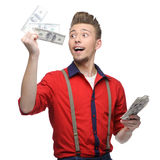Cheerful retro man holding money Royalty Free Stock Image