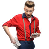 Cheerful retro man holding money Royalty Free Stock Images