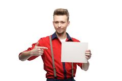 Cheerful retro man holding sign Royalty Free Stock Images