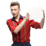 Cheerful retro man holding sign Royalty Free Stock Photography