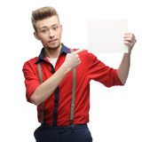 Cheerful retro man holding sign Royalty Free Stock Image