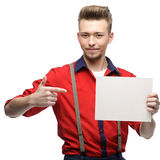 Cheerful retro man holding sign Stock Photo