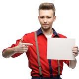 Cheerful retro man holding sign Stock Photo