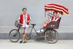 Cheerful rickshaw drivers having a break, Beijing, China Stock Image