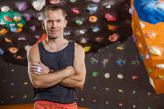 Cheerful rock climber in indoor climbing gym Royalty Free Stock Photography