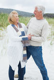 Cheerful romantic senior couple at beach Stock Photos