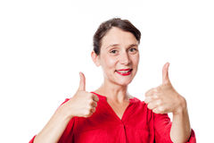 Cheerful 30s woman with two thumbs up approving Royalty Free Stock Image
