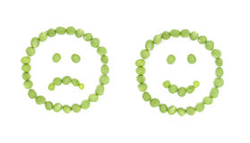 Cheerful and sad sign smile with green peas Stock Photo