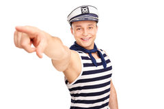 Cheerful sailor pointing forward with his finger Royalty Free Stock Image