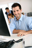 Cheerful salesman in office Royalty Free Stock Photography