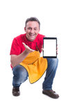 Cheerful salesman showing his modern tablet Royalty Free Stock Photography