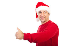 Cheerful Santa Claus giving thumbs Stock Photos