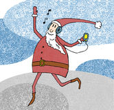 Cheerful Santa Claus listening player and dancing. Royalty Free Stock Photography