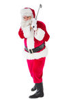 Cheerful santa claus playing golf