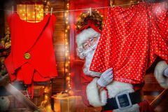 Cheerful santa claus. Portrait of cheerful Santa Claus in the courtyard of his house decorated with Christmas lights. Christmas and New Year concept stock images
