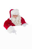 Cheerful santa claus presenting sign Royalty Free Stock Images