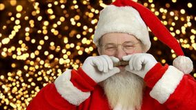 Cheerful Santa Claus. Santa touching beard and smiling. Traditions of Christmas stock video footage
