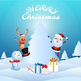 Cheerful santa claus, snowman, reindeer are christmas companion. Christmas presents in snow scene. Stock Photography